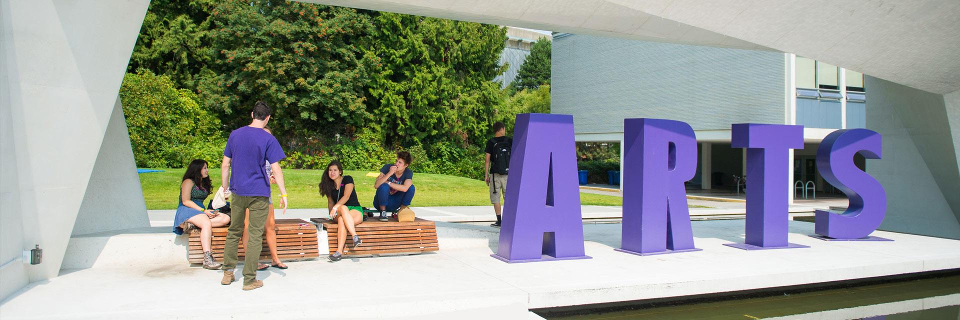 students sitting in Buchanan courtyard
